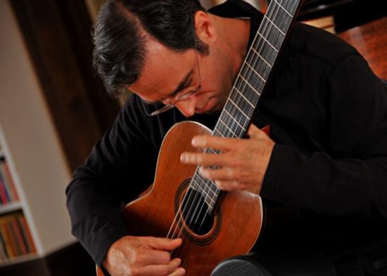 Charles Mokotoff plays guitar